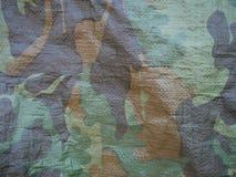 Brown- und grüne Tarnungsmilitärsegeltuchbeschaffenheit stockfotografie