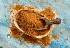 Brown unrefined cane sugar. In a bowl with a spoon close up Royalty Free Stock Photo