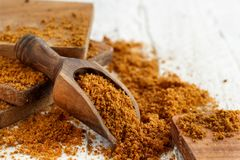 Brown unrefined cane sugar. With a spoon close up Royalty Free Stock Photo