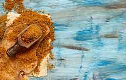 Brown unrefined cane sugar. With a spoon top view Stock Photo