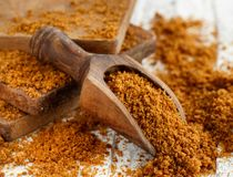 Brown unrefined cane sugar. With a spoon close up Royalty Free Stock Image