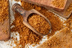 Brown unrefined cane sugar. With a spoon close up Royalty Free Stock Photography