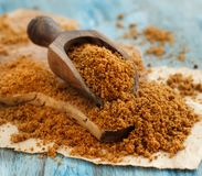 Brown unrefined cane sugar. With a spoon close up Stock Images