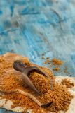 Brown unrefined cane sugar. With a spoon close up Stock Photography