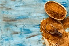 Brown unrefined cane sugar. With a spoon close up Stock Photos