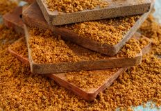 Brown unrefined cane sugar. On wood close up Royalty Free Stock Images