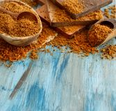 Brown unrefined cane sugar. On a wooden table close up Royalty Free Stock Photo