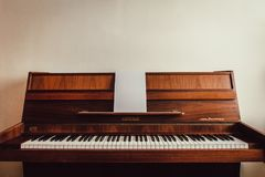 Brown Upright Piano royalty free stock photos