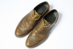 Brown used budapester shoes on white background Stock Photography