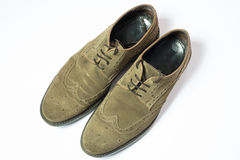 Brown used budapester suede shoes on white background Royalty Free Stock Photos