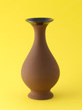 Brown vases on yellow Stock Photo