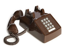 Brown Vintage Desk Phone. Old Desk Phone off the hook Stock Photo