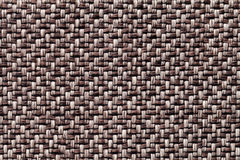 Brown vintage fabric with woven texture closeup. Textile macro background. Royalty Free Stock Image