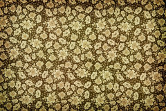 Brown vintage floral wallpaper. Background of brown vintage floral wallpaper with a closely packed pattern of flower heads stock images