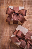 Brown vintage gift boxes on old wooden boiard Royalty Free Stock Image
