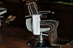 Brown vintage leather chair at stylish barber shop stock image