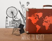 Brown vintage suitcase with map Royalty Free Stock Photos