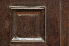 Brown vintage wooden door close up. Background royalty free stock images