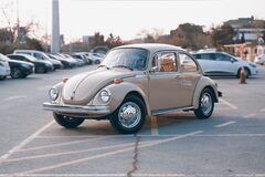 Brown Volkswagen Beetle at Parking Lot Stock Images