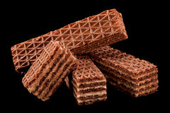 Brown wafer on black Royalty Free Stock Images