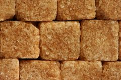Brown wall of sugar cubes. Filling the whole frame Royalty Free Stock Photography