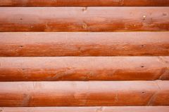Brown wall of wooden logs stock photos
