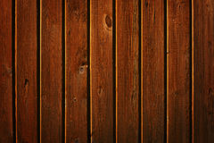 Brown wall of wooden planks Stock Images