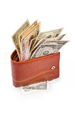 Brown wallet. With US Paper Currency on the white background Royalty Free Stock Photography