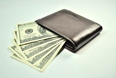 Brown Wallet And 100 Dollar US Bills Stock Photos