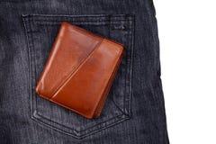 Brown wallet on black jean Stock Photos