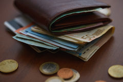 Brown wallet with euro money inside and coins, credit cards near Royalty Free Stock Photos