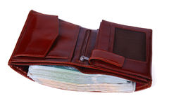 A brown wallet full of money isolated Royalty Free Stock Photos