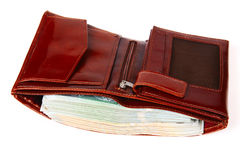 A brown wallet full of money isolated Stock Images