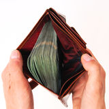 A brown wallet full of money isolated Stock Image