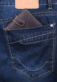 Brown wallet in the jeans pocket Stock Photo
