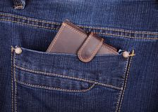 Brown wallet in the jeans pocket Stock Photography