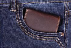 Brown wallet in the jeans pocket Royalty Free Stock Images