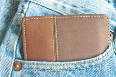 Brown wallet in jeans trousers back pocket Stock Image