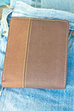 Brown wallet in jeans trousers back pocket Royalty Free Stock Photos