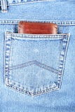 Brown wallet in pocket Stock Image