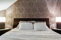 Brown wallpaper in elegant bedroom Stock Photography