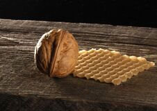 Brown Walnut on Brown Wooden Surface Royalty Free Stock Images