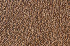 Brown-Wassermuster gefangen in der Bewegung Stockfoto