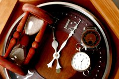Brown watch, clock and hourglass Stock Photography