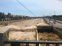 Brown water flood on Rimac river after heavy rain in Lima stock photography