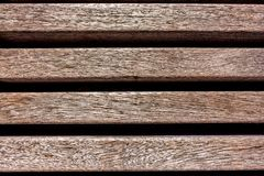 brown weathered bench in the sun high angle shot royalty free stock photos