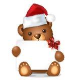 Brown-Weihnachtsbär mit Kartensitzen Stockfotos