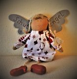 Brown and White Angel Doll stock image