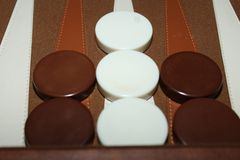 Brown and white backgammon pieces royalty free illustration