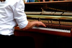 Brown White and Beige Upright Piano stock images